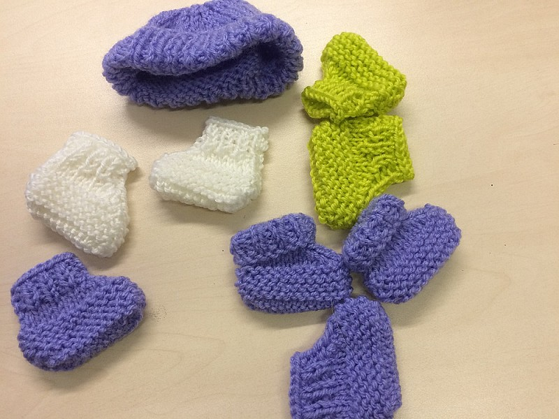 Knitted socks and hood for premature babies