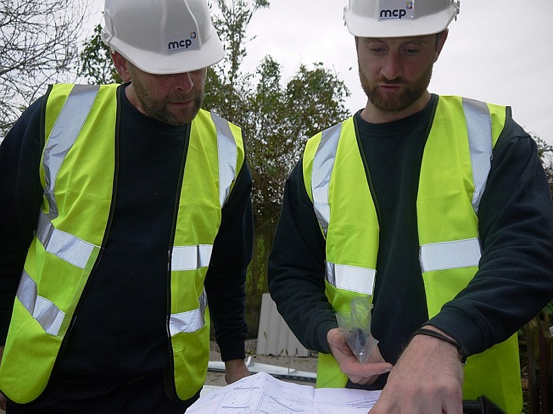 MCP Operatives discuss the construction