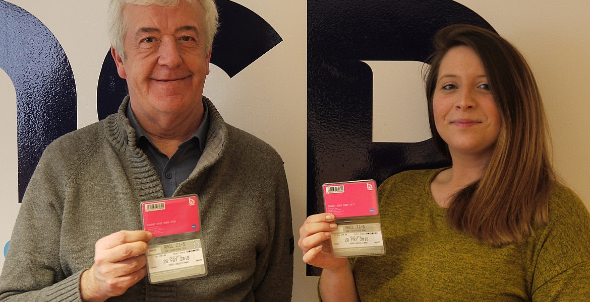Bob and Natalie proudly show off their travel passes